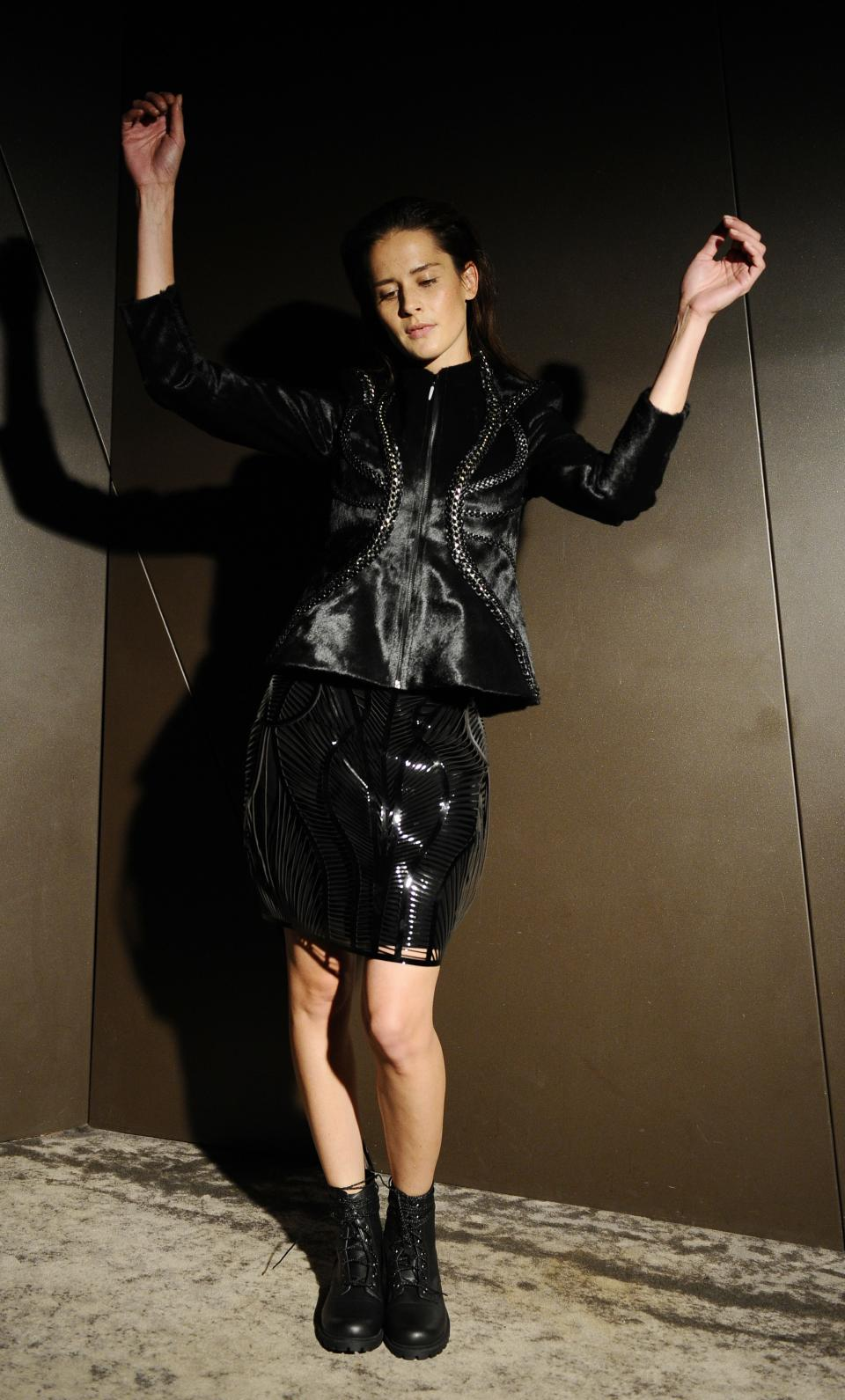 A model wears a creation for Dutch fashion designer Iris van Herpen's ready-to-wear Spring/Summer 2014 fashion collection, presented in Paris, Tuesday, Oct.1, 2013. (AP Photo/Zacharie Scheurer)
