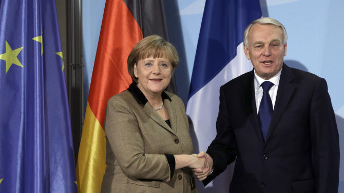 German Chancellor Angela Merkel, left, and the Prime Minister of France, Jean-Marc Ayrault, right, shake hands after a joint press conference as part of a meeting at the chancellery in Berlin, Germany, Thursday, Nov. 15, 2012. (AP Photo/Michael Sohn)