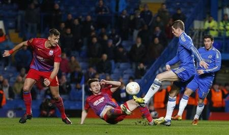 Fernando Torres of Chelsea tries to get round Lukasz Szukala and Adrian Popa of Steaua Bucharest during their Europa League match at Stamford Bridge in London