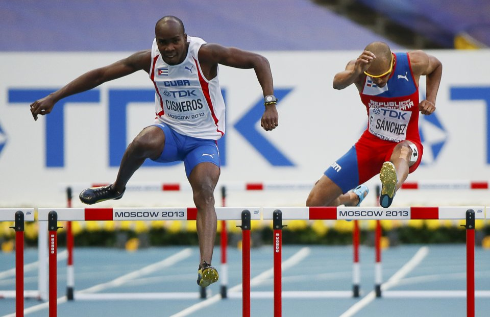 Cisneros of Cuba competes with Sanchez of the Dominican Republic compete in the men's 400 metres hurdles semi-final heat event of the IAAF World Athletics Championships at the Luzhniki Stadium in Moscow