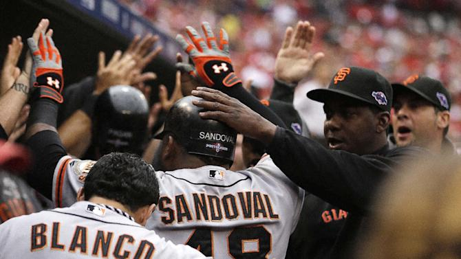 San Francisco Giants' Pablo Sandoval (48) celebrates a run as he walks into the dugout during the third inning of Game 3 of baseball's National League championship series against the St. Louis Cardinals  Wednesday, Oct. 17, 2012, in St. Louis. (AP Photo/Jeff Roberson)