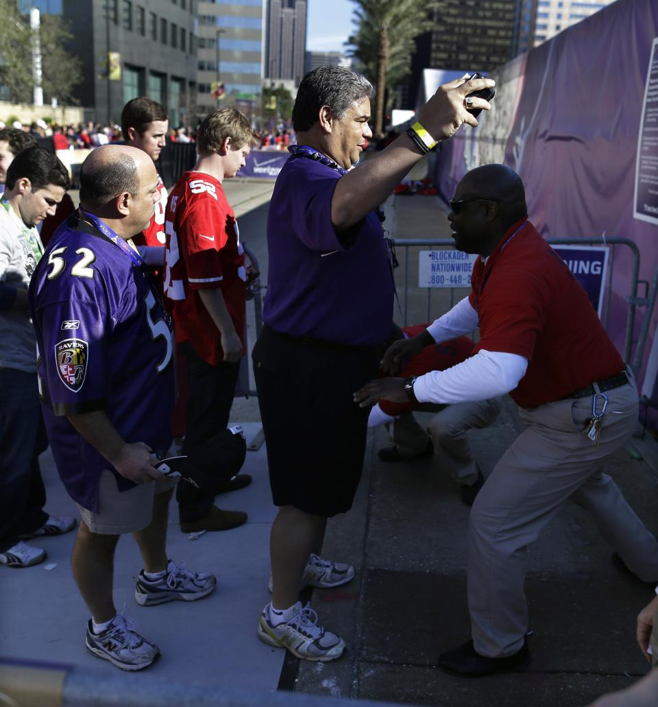 Clarence Lewis, right, searches fans before the NFL Super Bowl XLVII football game between the San Francisco 49ers and the Baltimore Ravens, Sunday, Feb. 3, 2013, in New Orleans. (AP Photo/Evan Vucci)