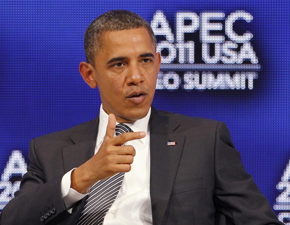 U.S. President Barack Obama speaks during a discussion at the APEC CEO Summit, a gathering of business leaders at the Asia-Pacific Economic Cooperation summit Saturday, Nov. 12, 2011, in Honolulu. (AP Photo/Andres Leighton)
