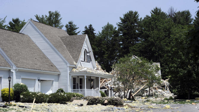 Debris from a demolished structure lays strewn about after an apparent gas explosion in a condominium complex Tuesday, June 25, 2013, in Yarmouth, Maine. One man was confirmed dead and more than 10 condos were damaged in the explosion. (AP Photo/Portland Press Herald, John Patriquin)