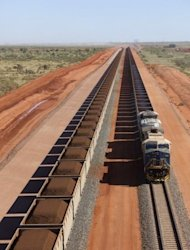 This handout photo, released by Fortescue, shows train carriages loaded with raw ore deposits being transported at Fortescue's Herb Elliot Port in western Australia. Billionaire founder of iron ore giant Fortescue Metals Group, Andrew Forrest, on Tuesday won a High Court appeal against a ruling that he misled investors on Chinese deals that could have seen him banned as a company director