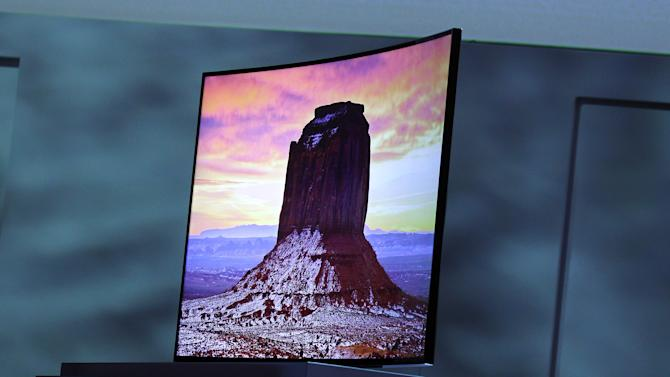 Samsung introduces an ultra high definition curved television during a news conference at the International Consumer Electronics Show, Monday, Jan. 6, 2014, in Las Vegas. (AP Photo/Isaac Brekken)