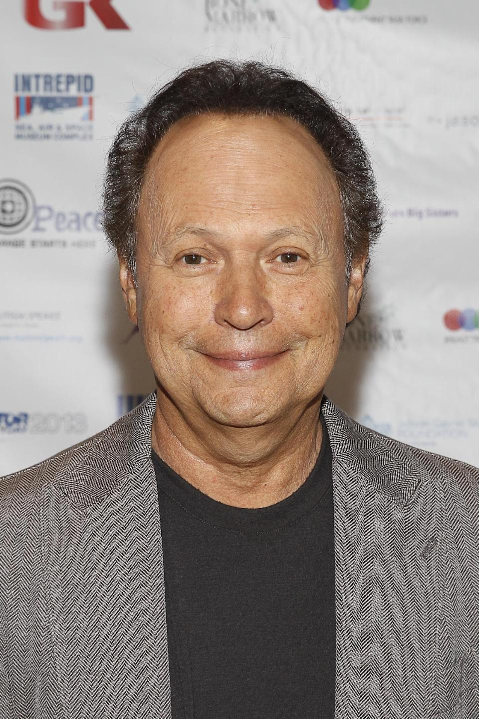 Billy Crystal arrives at the Annual Charity Day hosted by Cantor Fitzgerald and BGC Partners, on Wednesday, Sept. 11, 2013, in New York. (Photo by Mark Von Holden/Invision/AP)