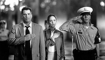 John Travolta , Madeleine Stowe and Timothy Hutton in The General's Daughter