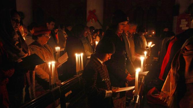 Pakistani Christians take part in a service to pray for victims of the attack by Taliban gunmen on the Army Public School in Peshawar, at the Cathedral Church in Lahore