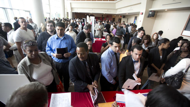 In this Tuesday, Jan. 22, 2013 photo, job seekers fill a room at the job fair in Sunrise, Fla. U.S. employers added 157,000 jobs in January, and hiring was much stronger at the end of 2012 than previously thought, providing reassurance that the job market held steady even as economic growth stalled, according to Labor Department reports, Friday, Feb. 1, 2013. (AP Photo/J Pat Carter)
