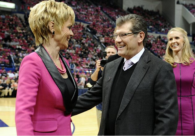 Baylor head coach Kim Mulkey, left, and Connecticut head coach Geno Auriemma, greet one another before an NCAA college basketball game between the two teams in Hartford, Conn., Monday, Feb. 18, 2013.