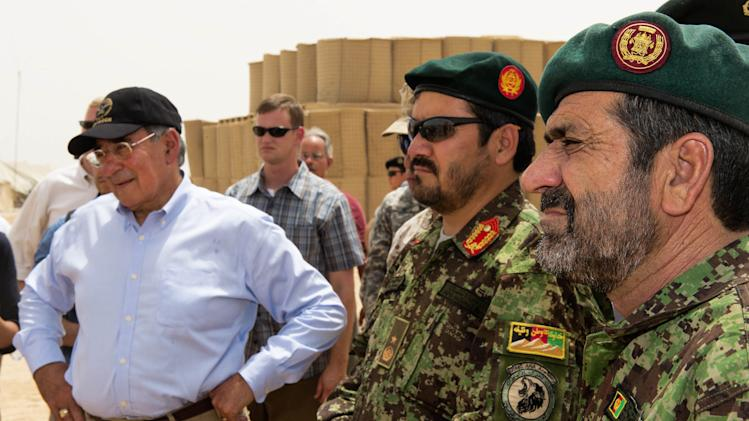 US Secretary of Defense Leon Panetta, left. and senior members of the Afghan Army watch demonstrations of mine and IED detection and clearing during an unannounced visit by the Secretary to Camp Dwyer, Sunday July 10, 2011, in southern Afghanistan. (AP  Photo/Paul J. Richards, Pool)