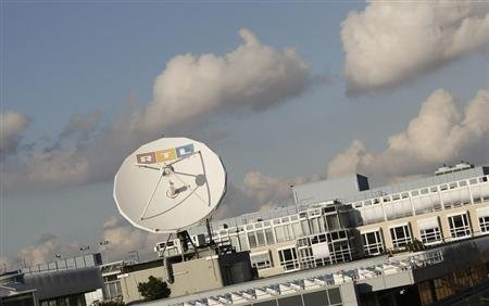 A satellite dish of RTL Television is seen on the roof of the former RTL headquarters in Cologne November 12, 2012. REUTERS/Wolfgang Rattay