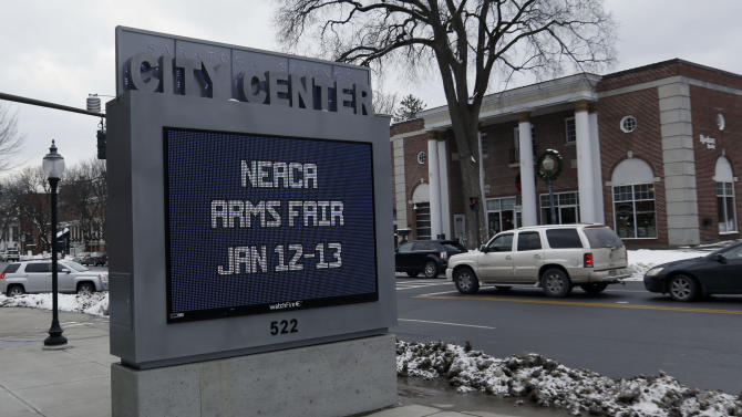 A sign at the Saratoga Springs City Center advertises an upcoming arms fair on Friday, Jan. 4, 2013, in Saratoga Springs, N.Y. (AP Photo/Mike Groll)