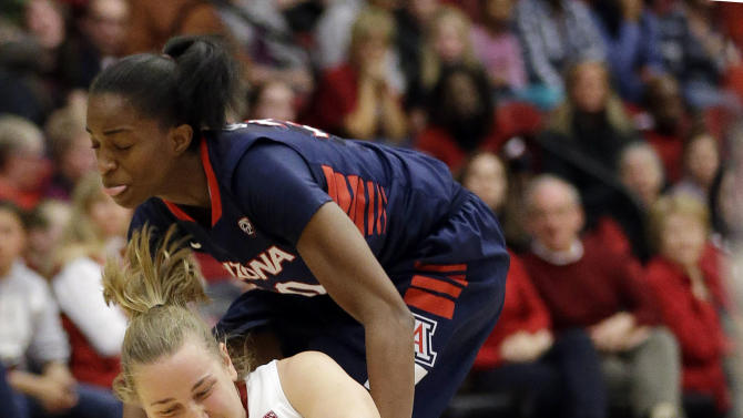 Stanford 's Mikaela Ruef, bottom, battles for a loose ball against Arizona 's Alli Gloyd during the first half of an NCAA college basketball game in Stanford, Calif., Friday, Feb. 8, 2013. (AP Photo/Marcio Jose Sanchez)