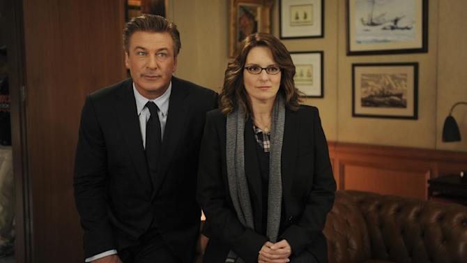 "In this 2011 image released by NBC, Alec Baldwin portrays Jack Donaghy, left, and Tina Fey portrays Liz Lemon in the NBC comedy series, ""30 Rock."" The series will broadcast live on Thursday, April 26, 2012.  (AP Photo/NBC, Ali Goldstein)"