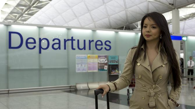 Miss World Canada Anastasia Lin poses for photo at the departure hall of Hong Kong Airport in Hong Kong, China