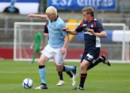 Ryan McGivern, left, has singed a loan deal at Hibernian