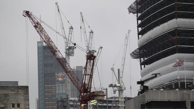 Construction cranes are seen in the City of London, Thursday, Oct. 25, 2012. Britain's economy grew by a bigger than expected 1 per cent between July and September, ending a shallow nine-month recession. The figure announced Thursday by the Office for National Statistics beat the market consensus forecast of 0.6 per cent growth. (AP Photo/Sang Tan)