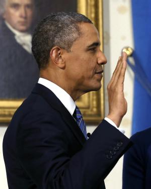 President Barack Obama is officially sworn-in by Chief Justice John Roberts, not pictured, in the Blue Room of the White House during the 57th Presidential Inauguration in Washington, Sunday, Jan. 20, 2013. (AP Photo/Larry Downing, Pool)