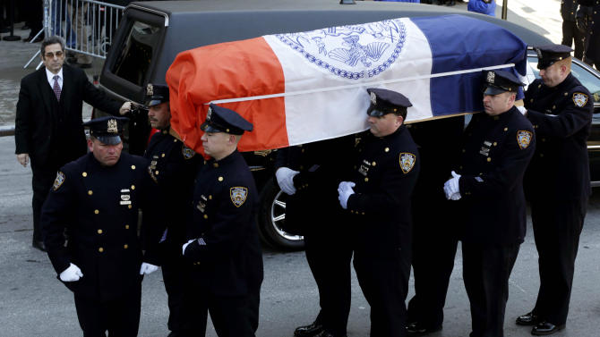 A casket containing the remains of former New York City Mayor Ed Koch is brought into Temple Emanu-El, at for his funeral in New York, Monday, Feb. 4, 2013. The crowd braved temperatures in the low 20s and a fierce wind while waiting in two lines outside the temple. Koch died Friday, Feb. 1, 2013. (AP Photo/Seth Wenig)