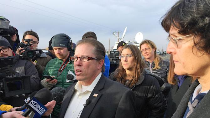 From left, Nevada Assemblyman John Moore, Idaho Rep. Heather Scott and Idaho Rep. Judy Boyle speak to reporters outside the Malheur Wildlife Refuge during the standoff near Burns, Ore., Thursday, Feb. 11, 2016. The end of a nearly six-week-long standoff at an Oregon wildlife refuge played out live on the internet, with tens of thousands of people listening as supporters encouraged the last armed occupiers to surrender. The holdouts surrendered Thursday, having refused to leave the refuge after the group's leaders were arrested last month.(AP Photo/Rebecca Boone)
