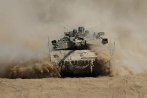 An Israeli tank manoeuvres outside the northern Gaza …