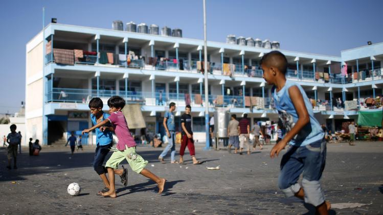 Palestinian boys, who fled houses following Israeli offensive, play soccer as they take refuge at a United Nations-run school in Jabaliya refugee camp in the northern Gaza Strip