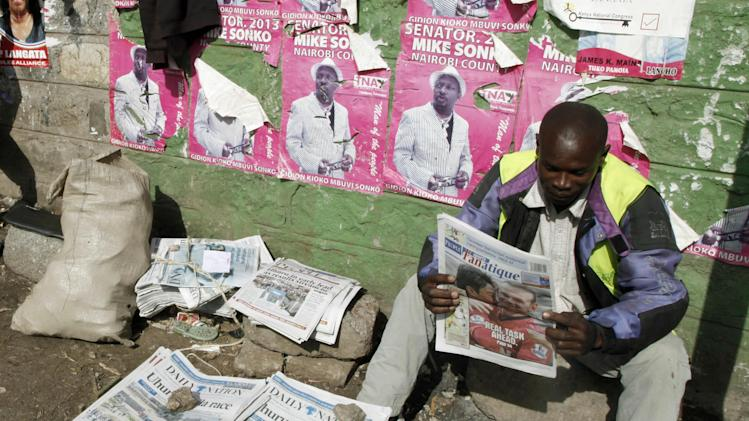 A Kenyan looks at a copy of a local newspaper, a day after the country's election, at a roadside stall in Nairobi, Kenya Tuesday, March 5, 2013. Election officials in Kenya are counting votes from the country's presidential election, and the candidate who faces charges at the International Criminal Court has taken an early lead. (AP Photo/Sayyid Azim)