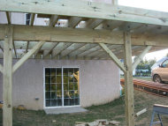 The hanging of the joists and placement of the posts required a professional contractor.