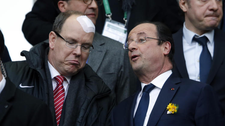 Prince Albert II of Monaco speaks with French President Hollande prior to the Six Nations rugby union match between Ireland and France in Saint-Denis, near Paris,