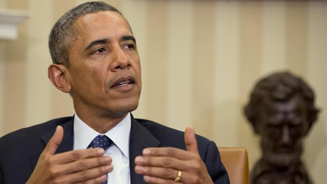 President Barack Obama speaks during a meeting with Spanish Prime Minister Mariano Rajoy in the Oval Office of the White House in Washington, Monday, Jan. 13, 2014. (AP Photo/Jacquelyn Martin)