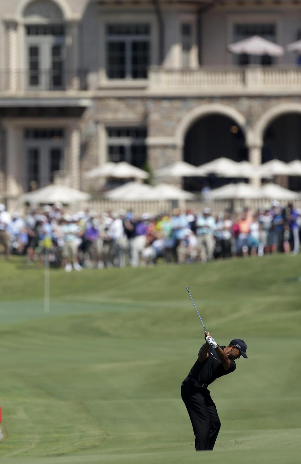 Tiger Woods hits on the 18th fairway during the second round of The Players championship golf tournament at TPC Sawgrass, Friday, May 10, 2013 in Ponte Vedra Beach, Fla. (AP Photo/Chris O'Meara)