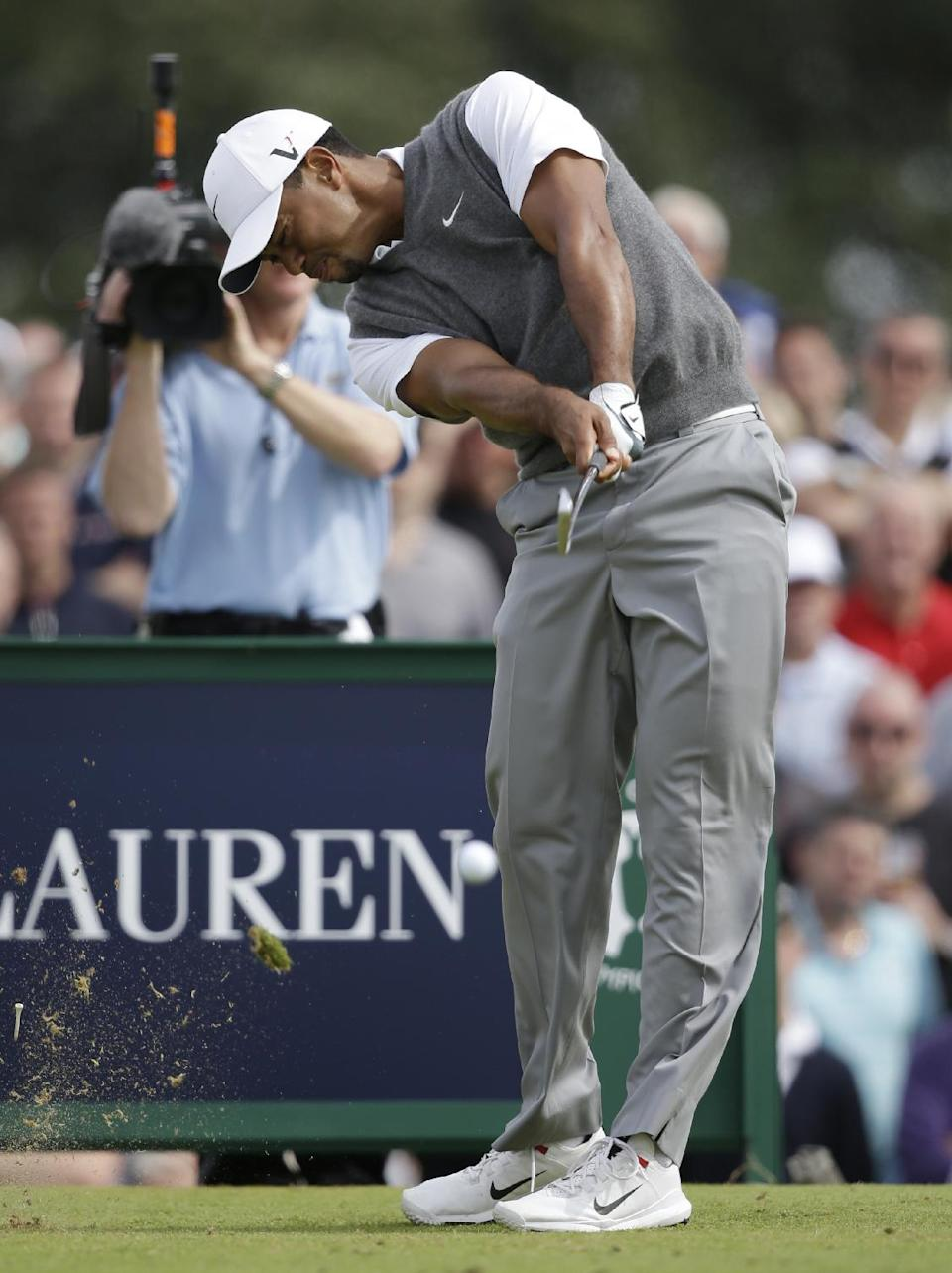 Tiger Woods of the United States plays a shot off the fourth tee at Royal Lytham & St Annes golf club during the third round of the British Open Golf Championship, Lytham St Annes, England, Saturday, July 21, 2012. (AP Photo/Tim Hales)