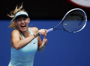 Maria Sharapova of Russia hits a return to Alize Cornet of France during their women's singles match at the Australian Open 2014 tennis tournament in Melbourne