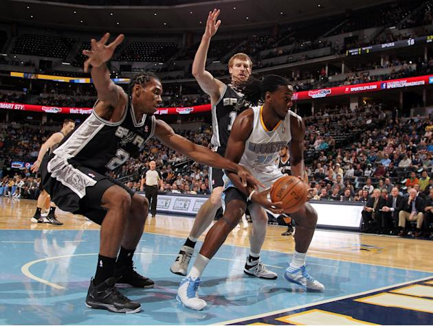 Denver Nuggets forward Kenneth Faried, front right, is trapped with the ball under the net by San Antonio Spurs forward Kawhi Leonard, front, left, and forward Matt Bonner, back, in the first quarter