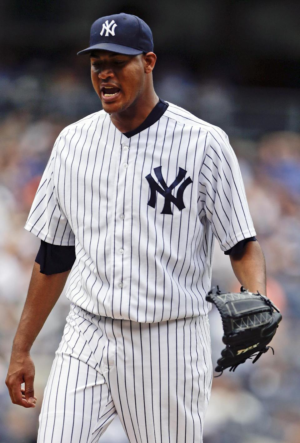 New York Yankees starting pitcher Ivan Nova reacts as he leaves the field during the sixth inning of a baseball game against the Tampa Bay Rays Saturday, July 27, 2013, in New York. The Rays won the game 1-0. (AP Photo/Frank Franklin II)