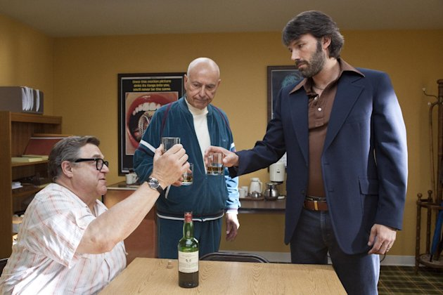 "FILE - This publicity image released by Warner Bros. Pictures shows John Goodman, left, Alan Arkin, center, and actor-director Ben Affleck in a scene from ""Argo."" The film has dominated the awards picture with wins at the Golden Globes and ceremonies held by the Directors Guild of America, the Screen Actors Guild and the Producers Guild of America. ""Argo"" now is poised to do what only four movies have managed before at the Oscars: win best picture without a nomination for its director. (AP Photo/Warner Bros. Pictures, Claire Folger, File)"