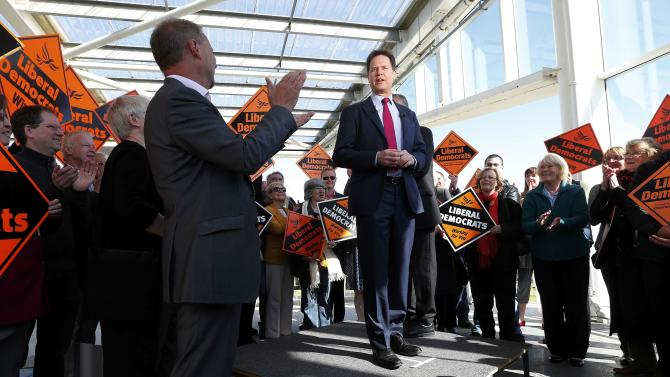 Britain's deputy Prime Minister and Liberal Democrat Party leader Clegg is applauded during a campaign event at the Ageas Bowl in Southampton, southern England