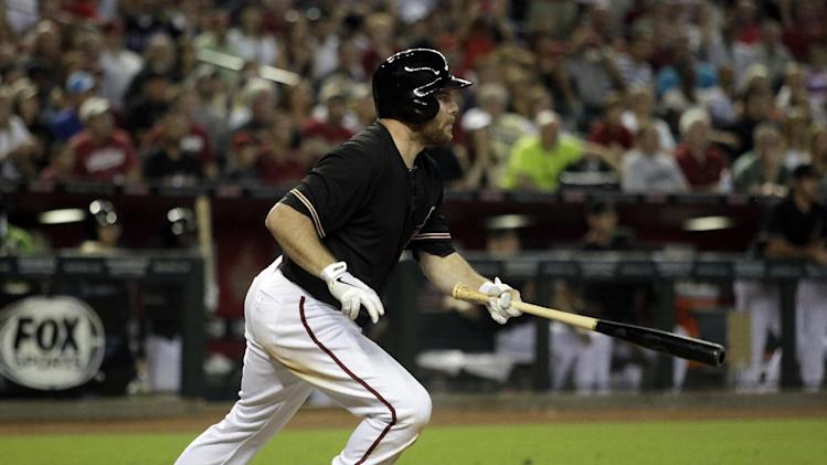 Arizona Diamondbacks' Jason Kubel hits a walkoff two-run single to defeat the Cincinnati Reds 4-3 in a baseball game on Saturday, June 22, 2013, in Phoenix. (AP Photo/Rick Scuteri)