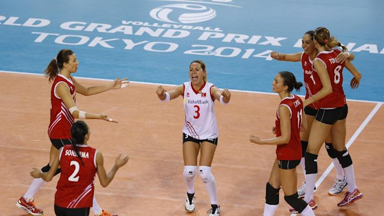 Turkey's players, from left, Neriman Ozsoy, Gozde Sonsima (2), Gizem Karadayi, Naz Aydemir Akyol, Guldeniz Onal and Bahar Toksoy Guidetti (8) celebrate after getting a point against Brazil during their Women's Volleyball World Grand Prix final round in Tokyo, Wednesday, Aug. 20, 2014. Turkey won the match (AP Photo/Shizuo Kambayashi)