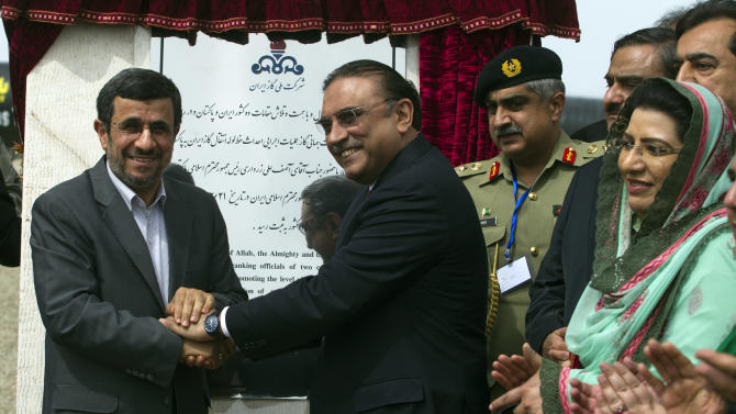 "Iranian President Mahmoud Ahmadinejad, left, shakes hands with his Pakistani counterpart Asif Ali Zardari after inaugurating the Pakistan-Iran Gas Pipeline Project in Chahbahar near the Pakistani border in Iran on Monday, March 11, 2013. The Iran-Pakistan pipeline is intended to help Pakistan overcome its mushrooming energy needs at a time when the country is facing increased blackouts and energy shortages. Ahmadinejad said Monday that the West ""has no right to obstruct."" (AP Photo/B.K. Bangash)"