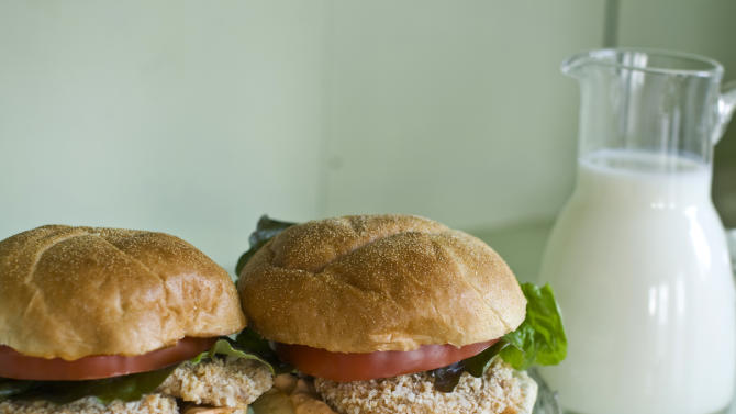 This undated image shows buttermilk-soaked pork tenderloin cutlet sandwiches in Concord, N.H. The acid in the buttermilk also helps to tenderize the meat. (AP Photo/Matthew Mead)