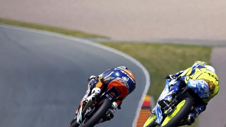 KTM Moto3 rider Miller of Australia is followed by Mahindra Moto3 rider Binder of South Africa during the German Grand Prix at the Sachsenring circuit in the eastern German town of Hohenstein-Ernstthal