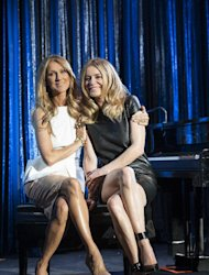 Celine Dion, left, and Veronic DiCaire pose for a portrait at the Jubilee Theatre on Friday, June 28, 2013 in Las Vegas. Celine Dion is throwing her star power behind a fellow French Canadian songstress Veronic DiCaire, who is setting up shop across the street in Las Vegas.(Photo by Eric Jamison/Invision/AP)