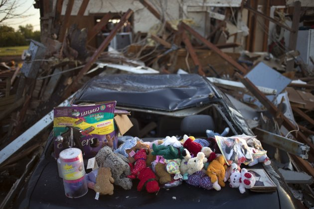 Stuffed animals salvaged from debris are left on top of a damaged vehicle in the Oklahoma City suburb of Moore, Oklahoma which was  left devastated by a tornado