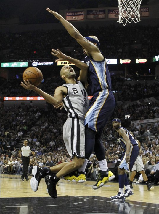 Spurs' Parker drives to the net on Grizzlies' Bayless during the second quarter in Game 2 of their NBA Western Conference final playoff basketball series in San Antonio