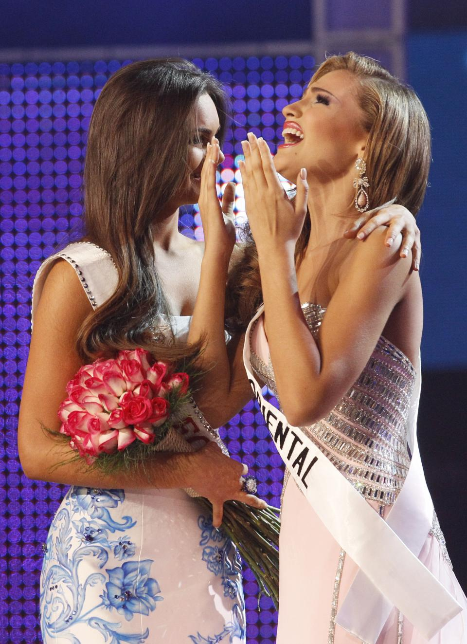Migbelis Castellanos, right, reacts after being selected as Miss Venezuela 2013 during the beauty pageant in Caracas, Venezuela, Thursday, Oct. 10, 2013. (AP Photo/Ariana Cubillos)