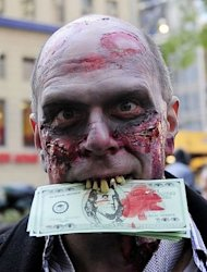 An Occupy Wall Street supporter dressed as a corporate zombie eats fake US dollar bills in New York in 2011. Twitter submitted to a New York court ruling and surrendered tweets sent by an Occupy Wall Street protester accused of disorderly conduct