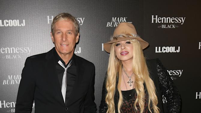Michael Bolton and Orianthi attend Hennessy Black: A Dinner with LL Cool J and Mark Burnett Celebrating Music's Biggest Night Out, on Sat., Feb., 9, 2013 in Los Angeles. (Photo by Casey Rodgers/Invision for Hennessy/AP Images)